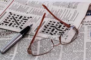 krant met puzzel pixabay